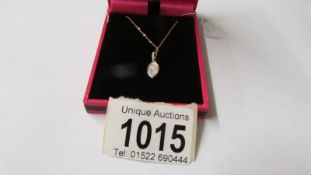 An 18ct rose gold lozenge shaped diamond pendant necklace of 25 points.