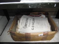 A box of sheet music.