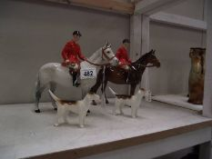2 Beswick horses with 2 hounds (grey horse has leg repair and other horse has head and foot repair)