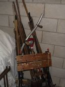 A good lot of garden tools and a work bench.