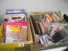 An interesting lot of maps, postcards, motoring books, speedway programmes, old radios etc.