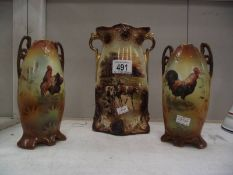 A pair of Staffordshire vases depicting cockerel's and one depicting cattle.