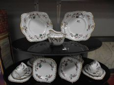 A 20 piece Tuscan hand painted teaset (4 cups only)