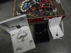 A mixed lot of vintage and costume jewellery including watches, pendant set etc.