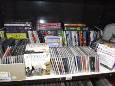 A large quantity of CD's, DVD's, Playstation games etc.