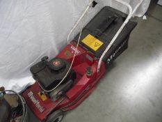 A Mountfield petrol lawn mower.