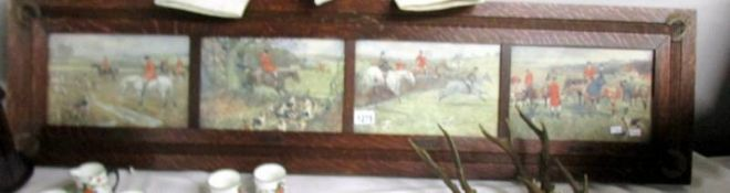 A set of 4 hunting prints in an oak frame.