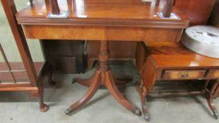 A Victorian mahogany fold over table.
