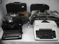 4 vintage typewriters including Royal, Olympia and Hermes.