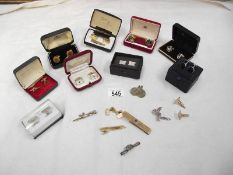 13 pairs of cuff links and 4 tie pins.