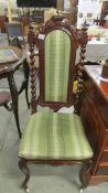 A Victorian mahogany cabriole leg nursing chair.