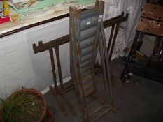 A pair of vintage car ramps and a good pair of metal trestles.
