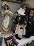 A quantity of collectors dolls and 4 books