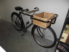 A vintage Raleigh bicycle with basket.