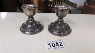 A pair of hall marked silver candlesticks.