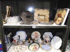 2 shelves of miscellaneous pottery and glass ware including place mats, Beswick miniatures etc.