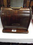A cased Lead machine sewing machine