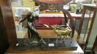 "A French art deco bronze figure on marble base with ivoreen head and hands ""Lady with Gazelle""."