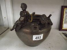 A bronze pot with 2 cherubs, a/f.