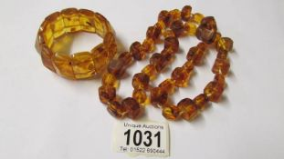 An amber style necklace with matching bracelet.
