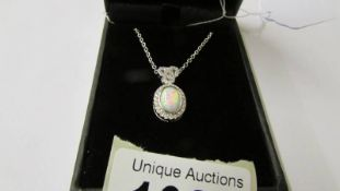 A silver CZ and opal panelled pendant necklace.