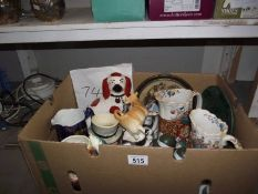 A box of pottery including character jugs, Staffordshire dog etc.