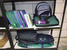2 shelves of Wimbledon books, holdalls and back packs etc.