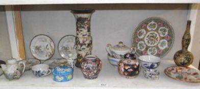 A mixed lot of oriental china including vases, plates etc.