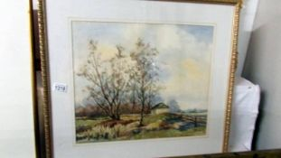 A framed and glazed rural watercolour signed John D Brownlow.