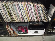 2 shelves of vinyl LP and 45 rpm records.