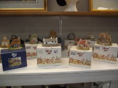 12 boxed Lilliput Lane cottages (some boxes a/f)