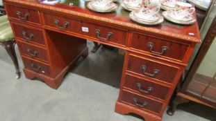 A good quality mahogany double pedestal desk with leather inset top.