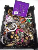 A crate of vintage costume jewellery.