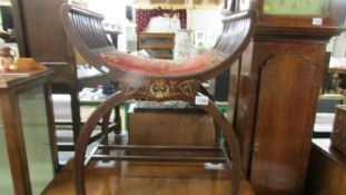 An Edwardian inlaid stool.