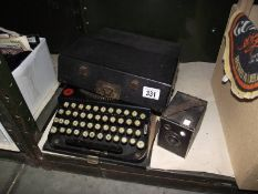 A cased Remington portable typewriter and a Brownie junior camera.