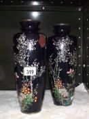 A pair of hand painted metal vases, (one a/f).