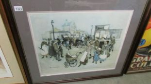 A framed and glazed street scene signed Chapman.