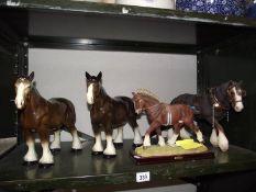 3 large cart horses.