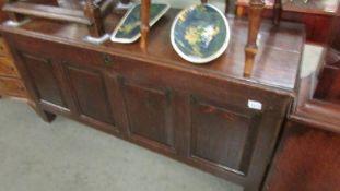 A large oak chest.