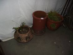 2 terracotta planters and a chimney top.