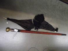 2 parasols a/f and a walking stick