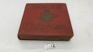 A Rare Ogdne's photo album, complete with titled cigarette type cards, all present.