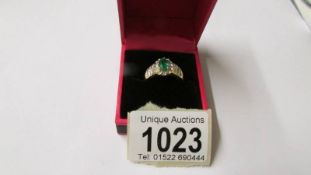 A 14ct yellow gold emerald and diamond ring of approximatley 1.5 carats, size P.