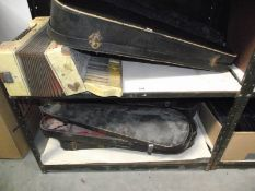 7 old empty violin cases and an old accordion, all a/f.