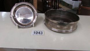 A hall marked silver wine coaster with wooden base and a small hall marked silver dish.