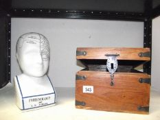 A phrenology head and a wooden box.