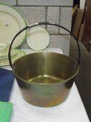 A Victorian brass jam pan.