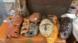 A good collection of tribal wall masks.