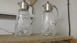 A pair of good quality cut glass claret jugs with plated fittings.