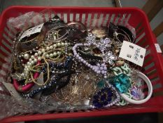 A basket of vintage and retro costume jewellery.